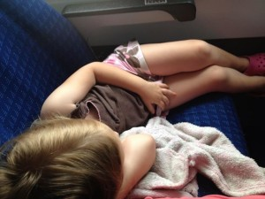 toddler sleeping on a plane