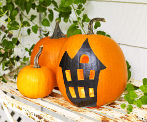 haunted house painted pumpkin